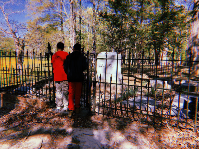 Johnny and his brother at the cemetery